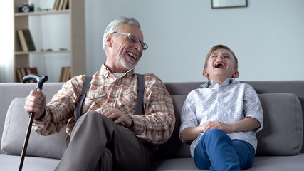 Old man and boy laughing genuinely, joking, valuable fun moments together Fototapete