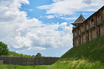 Fragment of a wooden fortress with tower, a wall and a palisade. Reconstruction of the fortress of the eleventh century, which is located in Ukraine, Kiev region, village Kopachov Wall mural