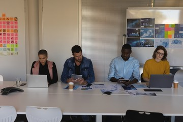 Executives working in conference room at office