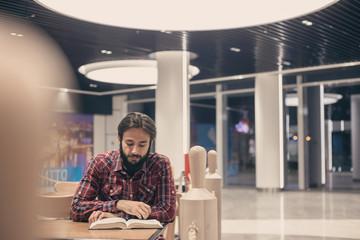 Modern man reads a book