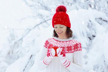 Woman drinks Christmas chocolate. Girl with cocoa.