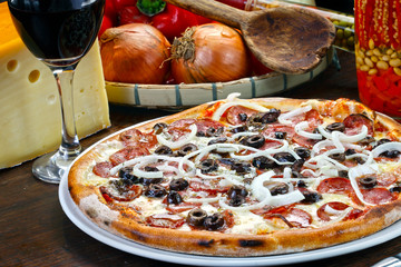 Pepperoni pizza and red wine