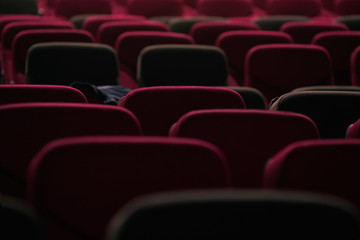 abstract red cinema seats in dark tone