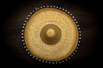 Sombrero on a dark background, top view.