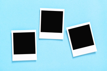 Retro style photo frames blue background