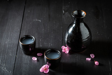 Sake in black ceramics on dark table