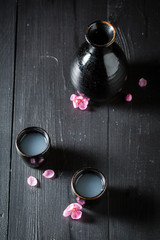 Top view of sake in black ceramics on black table