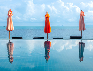 Umbrellas reflect with pool water