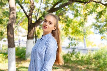 Autumn woman portrait outdoors at the park