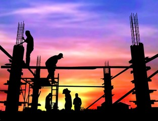 Silhouette construction workers group are pouring concrete on top of building in construction site with blurred colorful sunrise sky background, illustration mode
