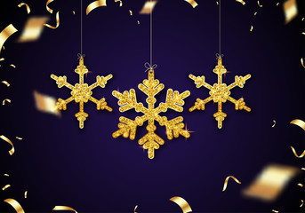 Christmas and New Year festive background with golden shiny snowflakes and confetti.