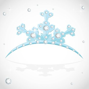 Blue snowflake shaped tiara for Christmas ball on a white background