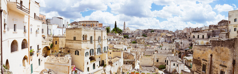 Spectacular panoramic view of ancient cave dwellings in Matera's Sasso Barisano, Italy