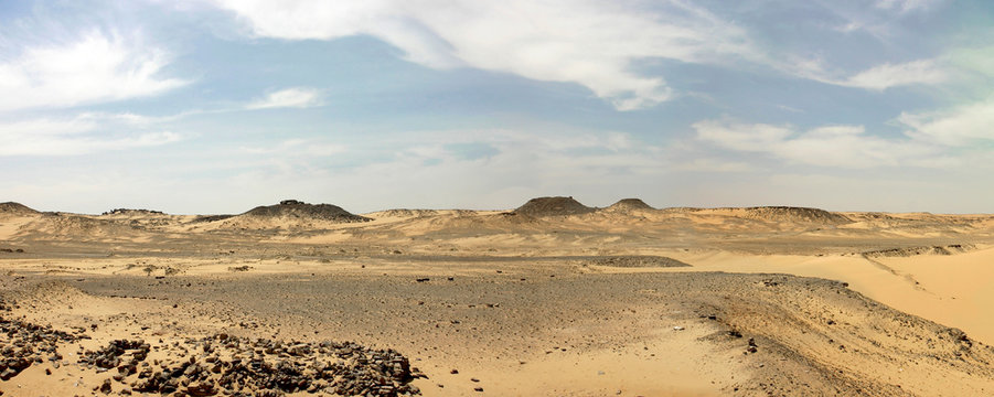 Libyan desert with cloudy blue sky in Egypt