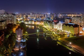 Night view of the center of Kaliningrad. Jubilee Bridge, Fish Village, Channels of the Pregolya River. Russia