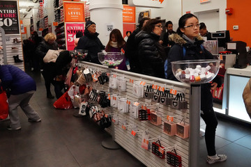 People line up to pay at a Payless shoe store during Black Friday shopping in New York City