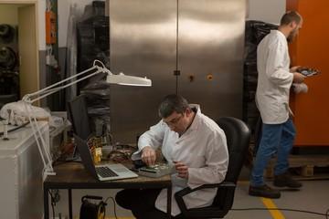 Robotics engineer working at desk