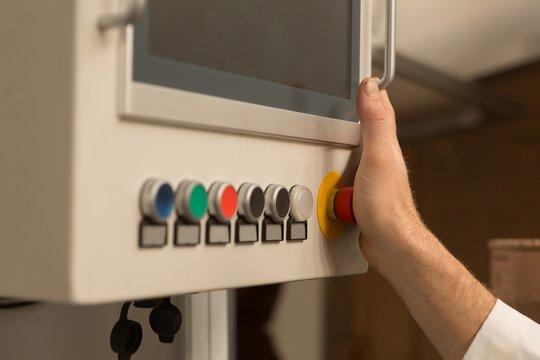 Robotics engineer controlling control panel in warehouse
