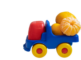 colorful toy car truck with spain mandarines