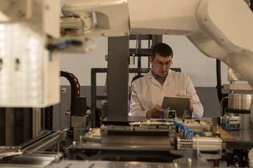 Robotic engineer using digital tablet