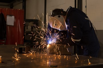 Robotic engineers using welding torch