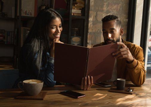 Couple looking at menu in cafe