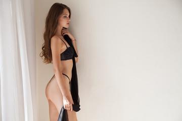 Portrait of beautiful fashionable women in underwear in the bedroom in the morning
