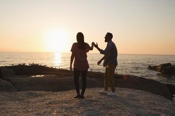 Couple standing near sea side