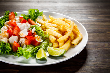 Fried cod and vegetables with french fries