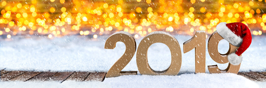 2019 happy new year christmas wide panorama greeting card number symbol santa hat lettering wooden snow background golden lights bokeh concept