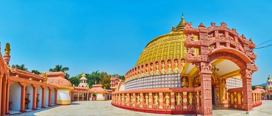 Panorama of the pagoda of Sitagu International Buddhist Academy, decorated with ornate terracotta torana gate, Sagaing, Myanmar.