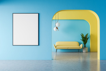 Blue and yellow living room, sofa and poster