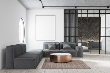 Living room with gray sofa and poster