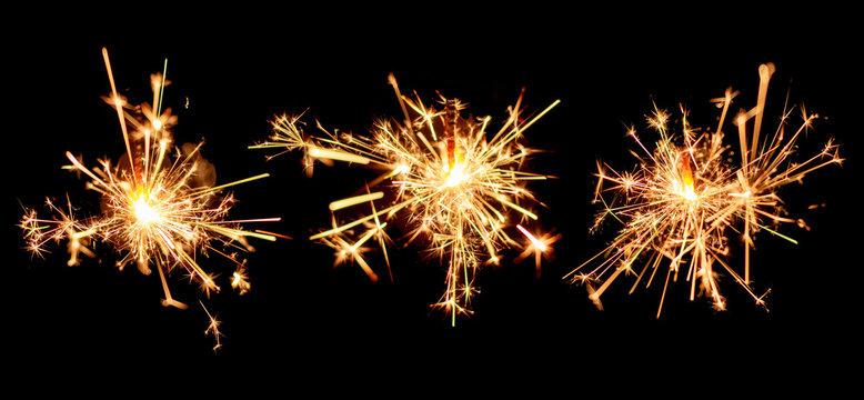 Set of sparkler burning isolated on black background.
