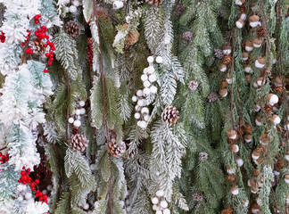 Christmas background with pine cones, acorns, twigs and snow. Christmas decor