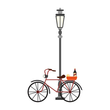 Vintage bike with wine and cheese on streetlight