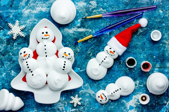 Funny meringue snowman food art idea for kids New Year and Christmas background