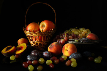 Still life with fruit on a dark background in the style of old Dutch artists
