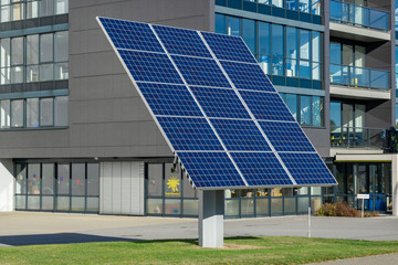 solar panels in front of a building