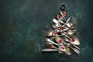 Abstract christmas tree made from vintage cutlery.Top view with copy space.