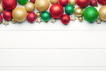 Wall Mural - Christmas baubles on white wooden background