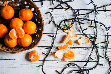 Tangerines and garland on the table