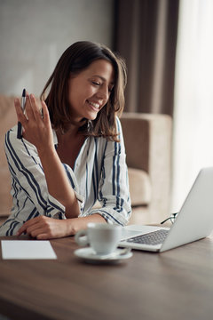 Smiling woman working from home on laptop -Businesswoman .