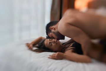 Sexy couple in passion - couple in bed having sex..