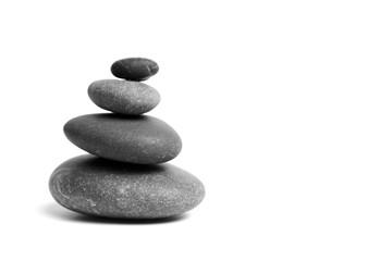 Obraz Stacked smooth grey stones. Sea pebble. Balancing pebbles isolated on white background - fototapety do salonu