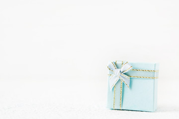 Blue gift box for holiday on light background