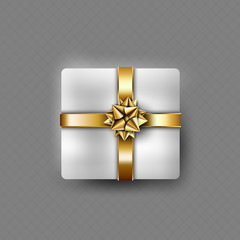 Present box with gold ribbon