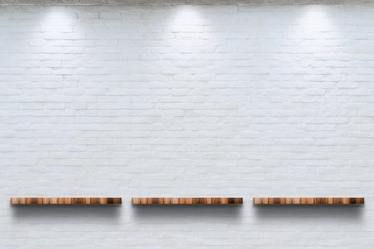 Empty top of wooden shelf with white brick wall background.
