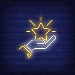 Shining star in hand neon sign. Luck, success or advertisement design. Night bright neon sign, colorful billboard, light banner. Vector illustration in neon style.
