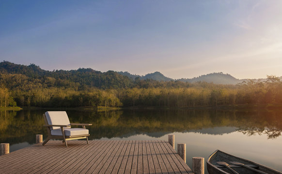 The wooden pier looks out to the lake, forest and mountain view 3d render,The atmosphere in the morning. The sunlight is golden and foggy.